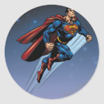 Superman against the night sky classic round sticker