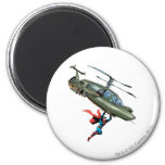 Superman holds helicopter 2 inch round magnet