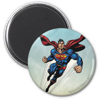 Superman leaps upward 2 inch round magnet