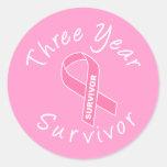 Superviviente de tres años (cinta rosada del etiquetas redondas