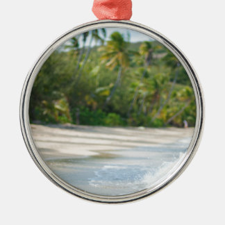 Surf breaking on a sandy beach metal ornament
