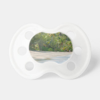Surf breaking on a sandy beach baby pacifiers