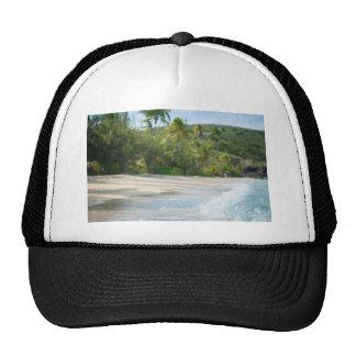 Surf breaking on a sandy beach trucker hat