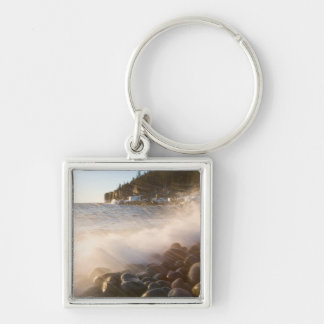 Surf washes over the cobblestones in Monument Keychain
