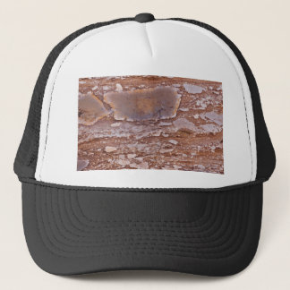 Surface of a red sandstone with siliceous geods trucker hat