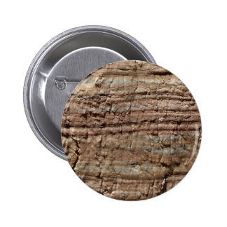 Surface of carbonate rock with weathering traces pinback button
