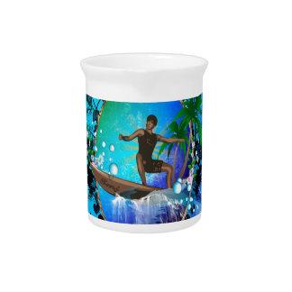 Surfboarder with water splash pitcher