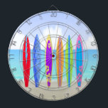 """Surfboards Beach Dart Board<br><div class=""""desc"""">Surfboards Beach Dart Board features a beach background with sand, ocean and sky, 6 colorfully decorated surfboards. Perfect gift for surfer in your life. Includes 6 brass darts (3 American flag dart flights and 3 UK dart flights). Regulation size board (18"""" diameter, 1"""" thick). Finished with aluminum frame and hanging...</div>"""