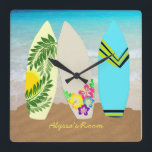 """Surfboards in Sand Personalized Square Wall Clock<br><div class=""""desc"""">Surfboards in sand, personalized wall clock. Artistic surfboards with tropical decor are stuck in sand at the waters edge in this fun design for a teen girls bedroom. Personalize with her name, or any text, at the bottom of a square or round clock, in bright yellow. Don&#39;t let the text...</div>"""