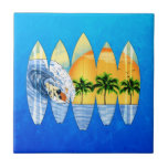 "Surfer And Surfboards Ceramic Tile<br><div class=""desc"">Mural style surfing art on surfboards side by side instead of a wall.</div>"
