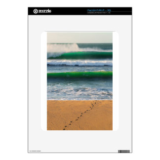 Surfer footprints on sand beach and green waves decals for the iPad