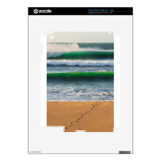 Surfer footprints on sand beach and green waves decals for the iPad 2