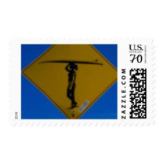 Surfer girl sign postage stamp