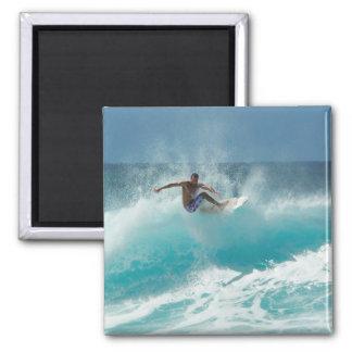 Surfer on a big wave magnet