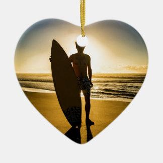 Surfer silhouette during sunrise ceramic ornament