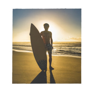 Surfer silhouette during sunrise notepad