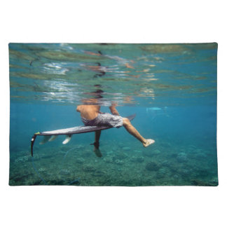 Surfer sitting on surfboard over coral reef cloth placemat