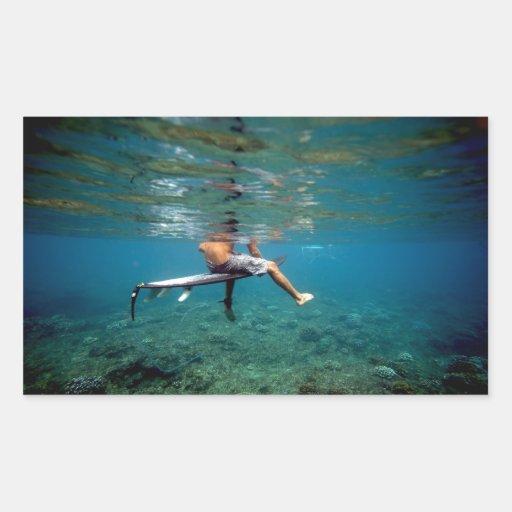 Surfer sitting on surfboard underwater green reef sticker
