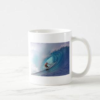 Surfer surfing a huge wave. coffee mug