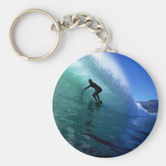 Surfer surfing the tube in green wave key chains
