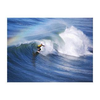 Surfer Under a Rainbow Canvas Print