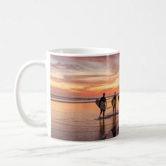 Surfers At Sunset Walking On Beach, Costa Rica Coffee Mug