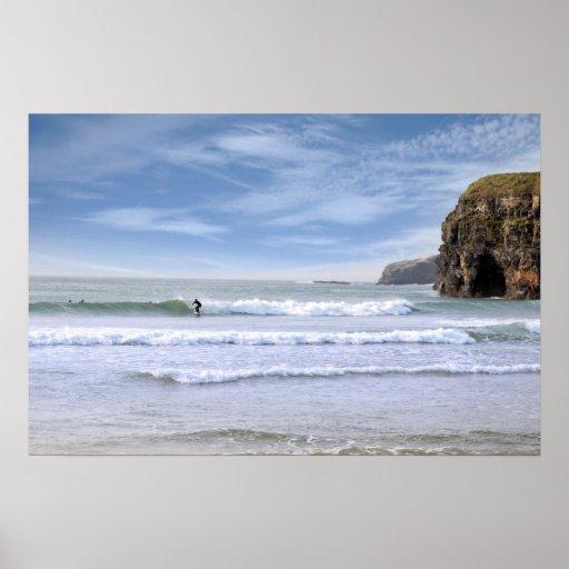 surfers near ballybunion cliffs poster