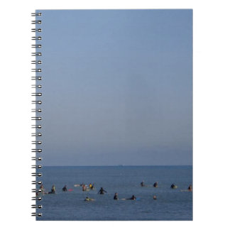 surfers waiting a wave notebook
