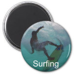 surfing at a big wave 2 inch round magnet