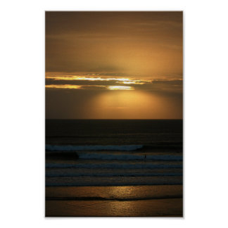 Surfing at sunset at Polzeath Poster