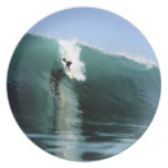 Surfing large green extreme surfing wave party plates