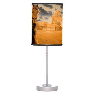 surreal horse walking down fence orange sky desk lamp