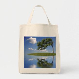 Surrealist island tote bag