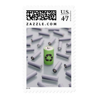 Surrounded by smaller grey batteries. postage