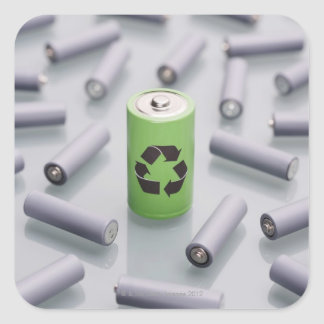 Surrounded by smaller grey batteries. square sticker