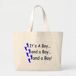 Sus tríos de un bebé del muchacho bolsa tela grande