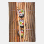 Sushi and wooden chopsticks hand towels