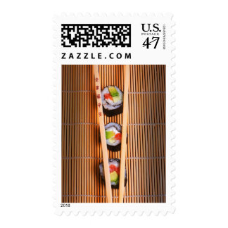 Sushi and wooden chopsticks postage