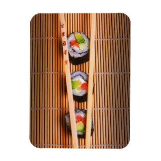 Sushi and wooden chopsticks rectangular photo magnet