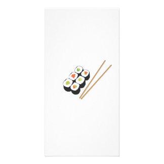 Sushi rolls with chopsticks photo card