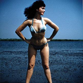 Bettie Page in a Blue Bikini Standing Beside Water