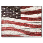 painted_american_flag_on_rustic_wood_texture_postc
