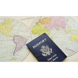 Close-up of passport lying on map