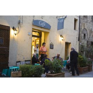 Italy, Tuscany, San Quirico. Locals chat
