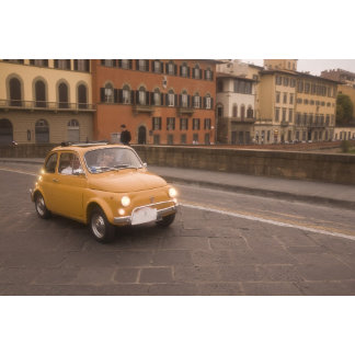 Italy, Florence. Fiat 800 Rally crosses Arno