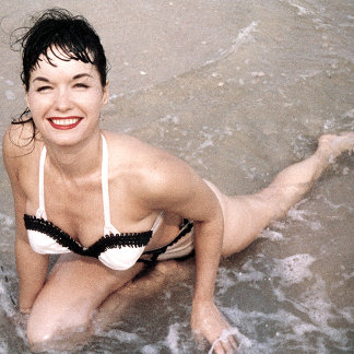 Bettie Page Smiling In the Surf on the Beach