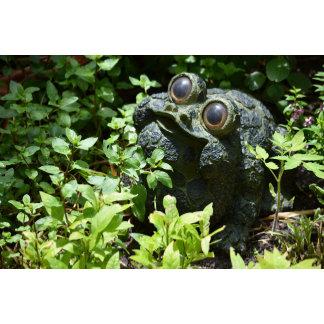 frog statue in basil plants cute garden figure