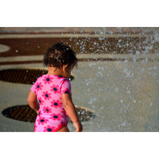 baby in pink onesie in fountain