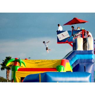 kid jumping off ride at carnival