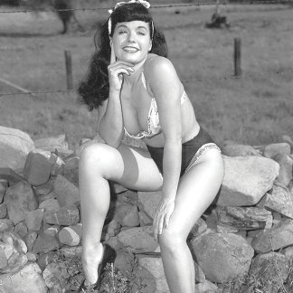 Bettie Page with a Beautiful Smile and Legs Pinup